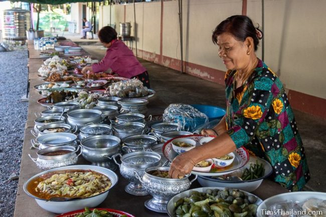 women putting food on a table