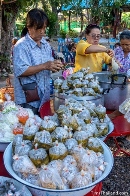 women putting food in bags