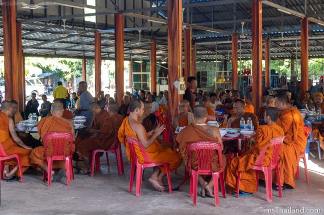 monks eating at tables