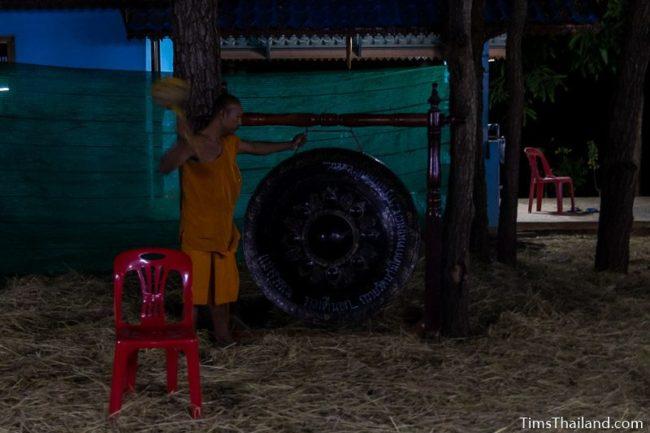 man hitting a gong