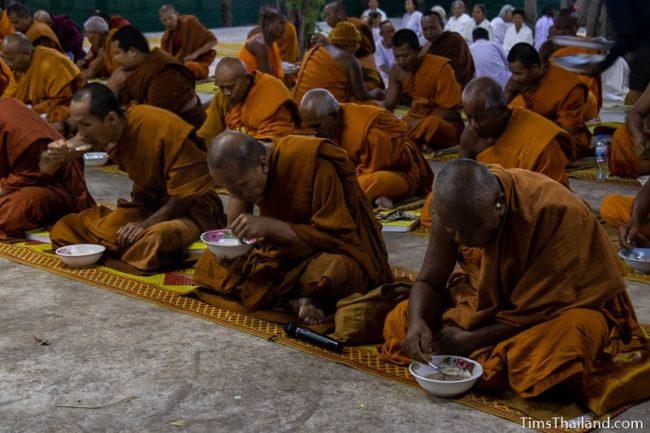 monks eating rice porridge