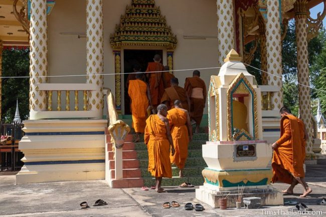 monks walking into the ubosot