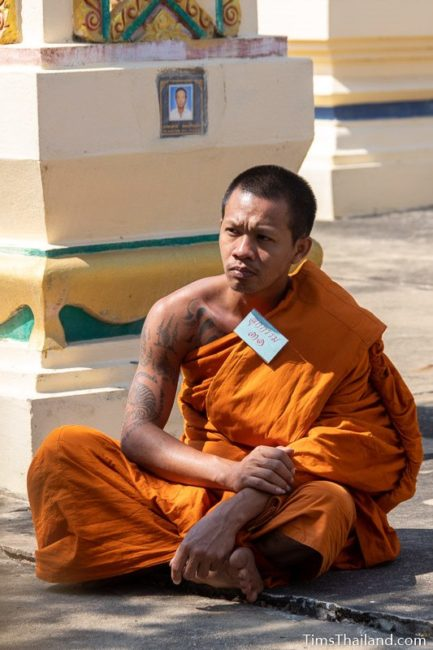 monk sitting on the ground