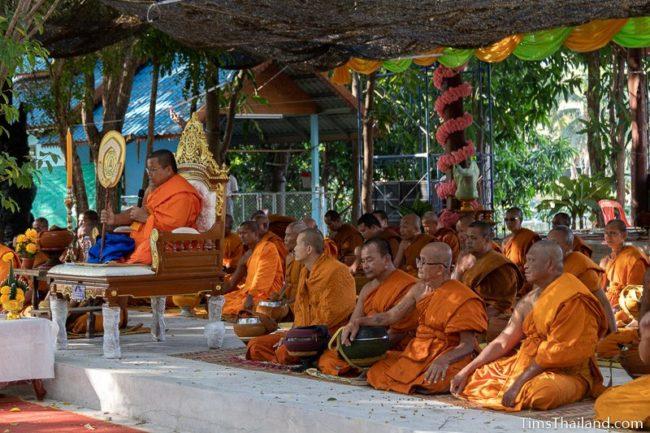 monks listening to a sermon