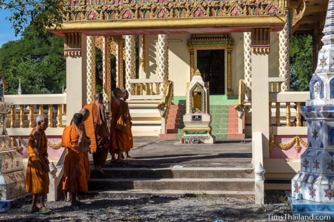 monks waiting in front of the ubosot