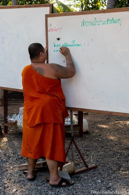 monk writing on whiteboard