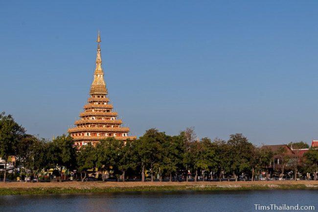 stupa seen from across a lake