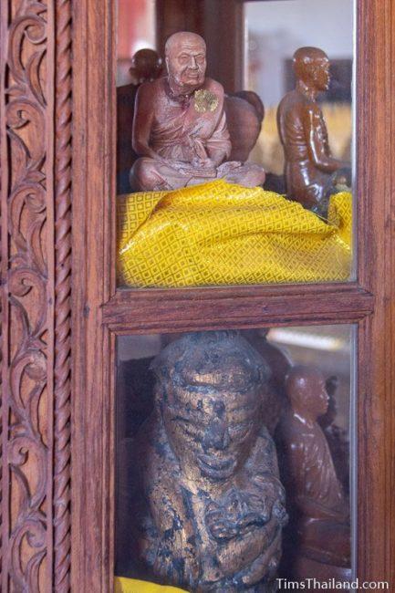 monk statues in a case