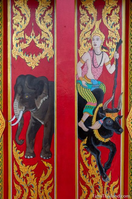 painted window shutter of elephant and a god riding a bull