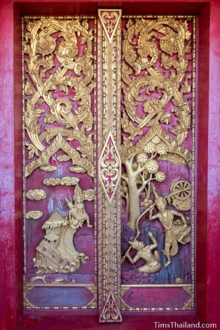 carved wood doors with two Jataka scenes