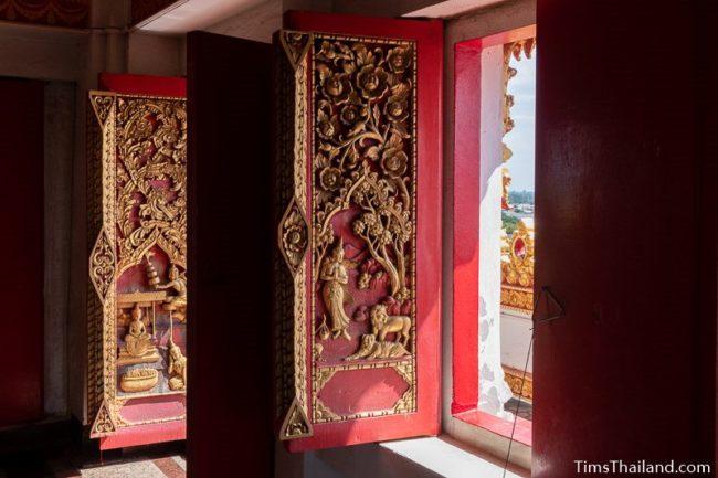 carved wood doors with Jataka scenes