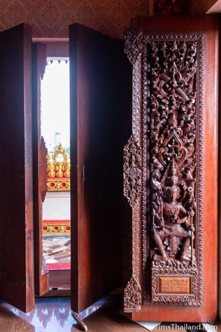 carved wood doors with gods