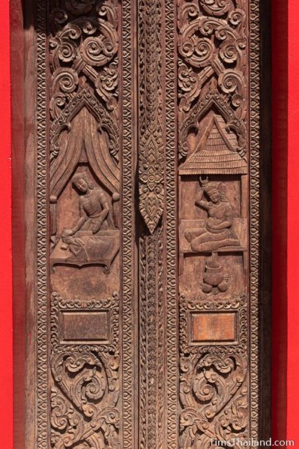 carved wood doors with birth scenes