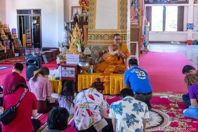 monk splashing water to bless people