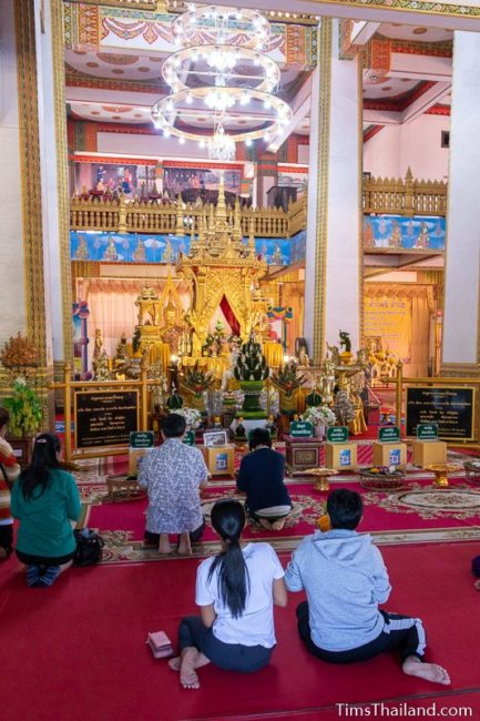 people praying in front of Buddha relic