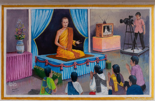 painting of monk on a TV show