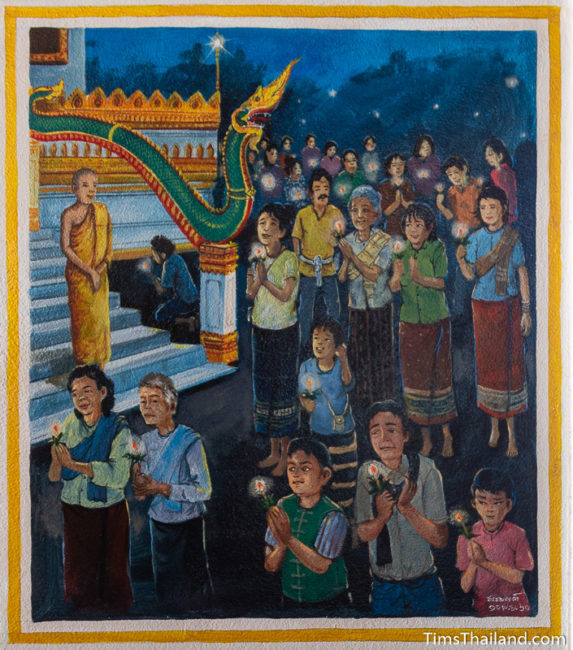 painting of people holding candles and walking around the stupa