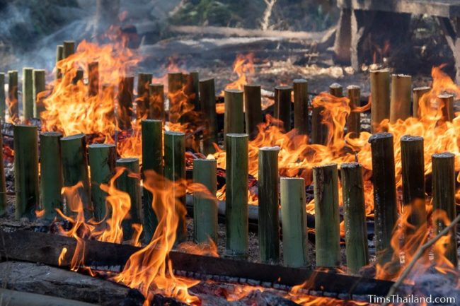 flames around bamboo tubes