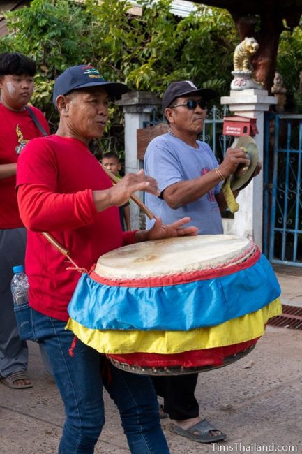 man playing drum in a parade