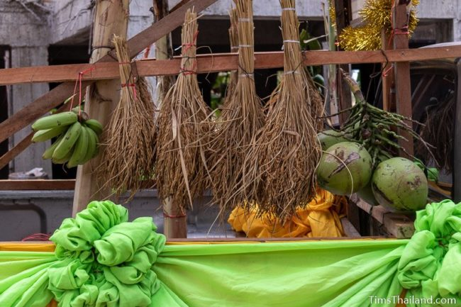rice, coconuts, and bananas hung on parade float truck