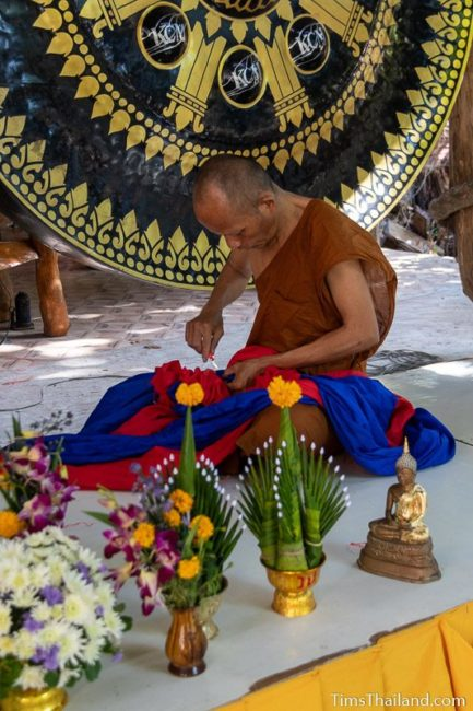 monk untying decorative fabric