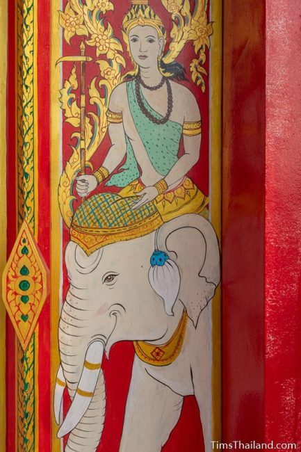 painting of the god Budha riding an elephant