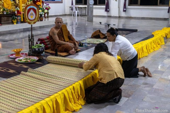 women decorating platform where monks sit
