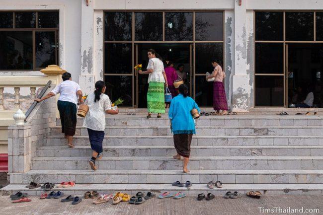women walking into sala