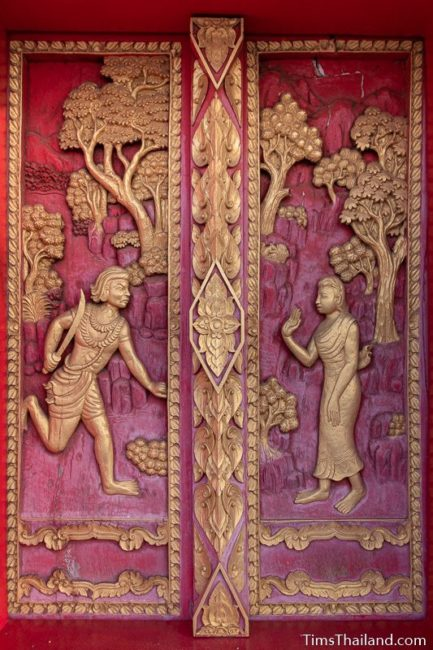woodcarving of Angulimala running to his mother