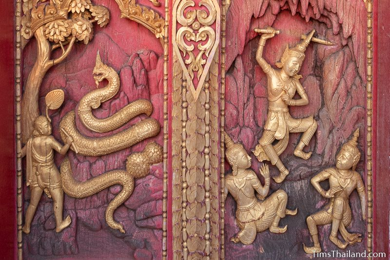 woodcarving of a giant naga and a man threatening two others with a sword