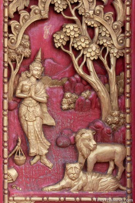 woodcarving of woman with lion and tiger.