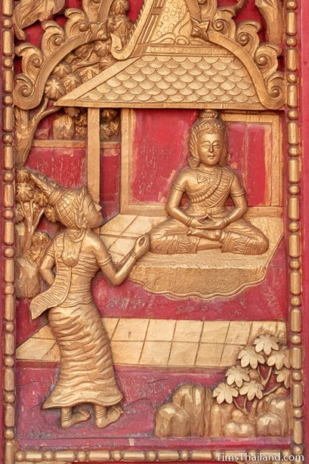 woodcarving of woman talking to man.