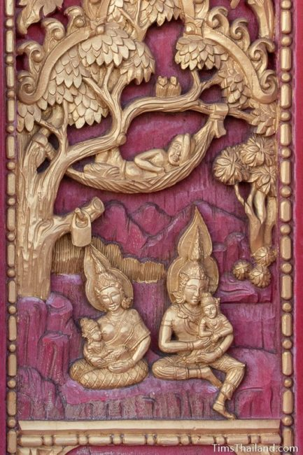 woodcarving of gods caring for kids with old man sleeps in a hammock.