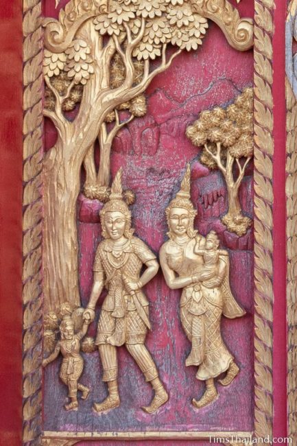 woodcarving of mother, father, and two kids walking.