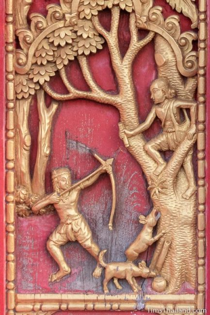 woodcarving of man shooting arrow at old man in a tree.