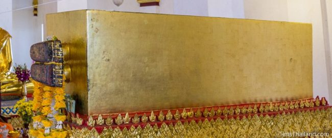 coffin with Buddha's feet sticking out