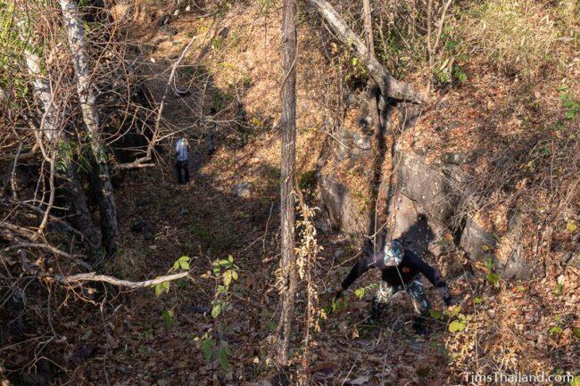 ranger climbing down into small valley