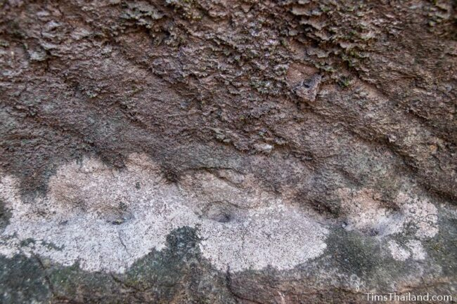 rock wall with cut marks