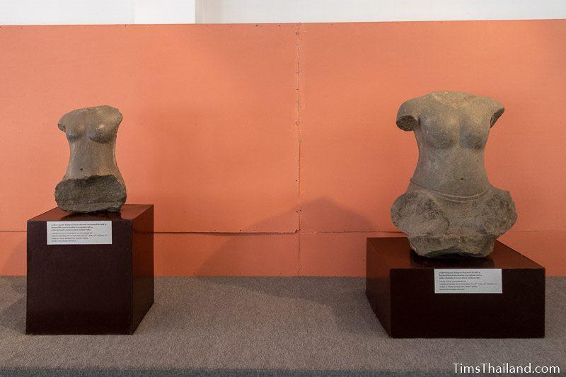 two statues of torsos in Phimai National Museum