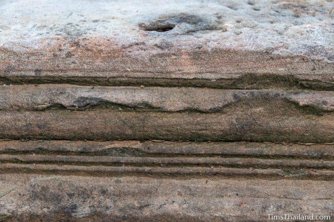 decorative lines carved on a sandstone block