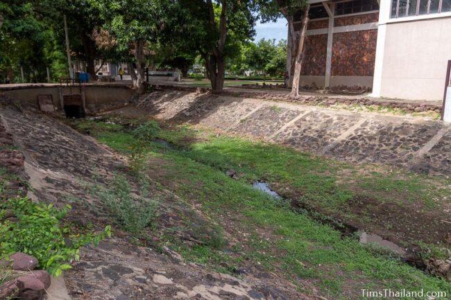 moat alongside Phimai National Museum building