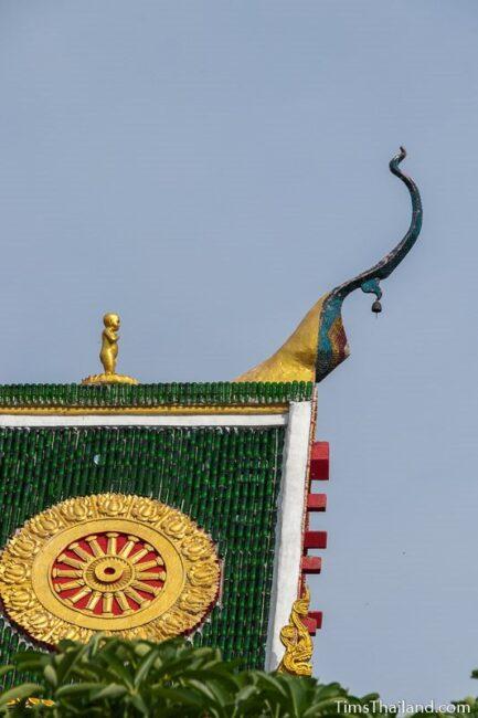 Baby Buddha statue on roof peak of ubusot
