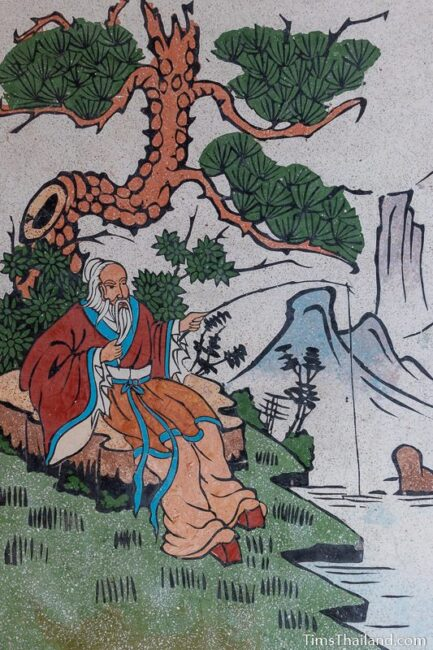 picture of man fishing on wall of Chinese shrine