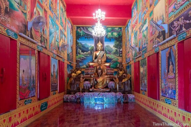 Buddhas and murals inside ubosot