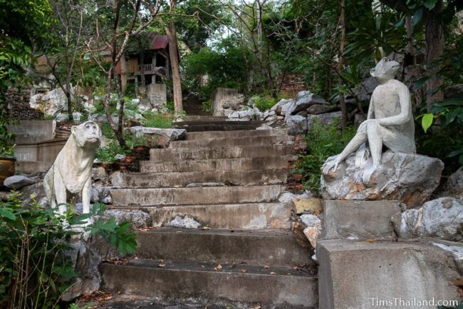two monkey statues along stairs
