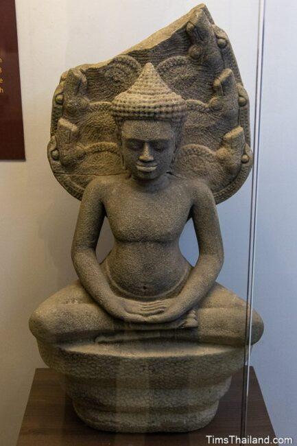 statue of Buddha under a naga