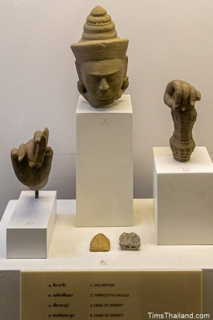 head and hands of a deity