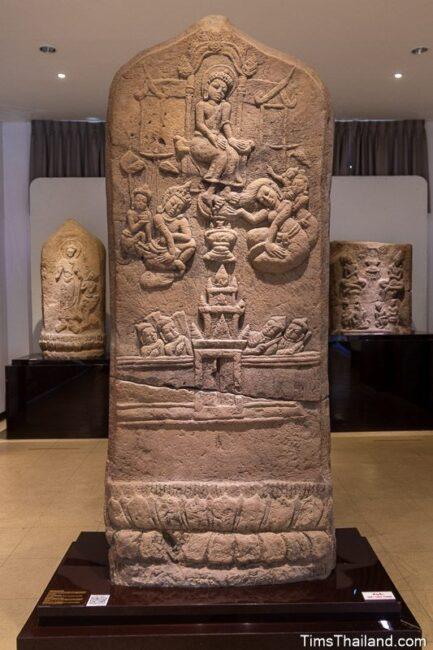 large bai sema boundary stone with Princess Princess Yasodhara cleaning Lord Buddha's feet with her hair