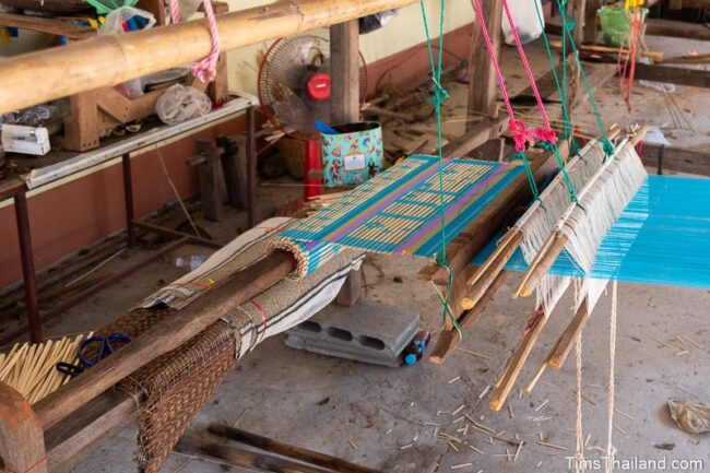loom with banner half woven