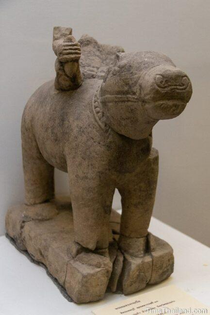 statue of buffalo with broken Yama riding it